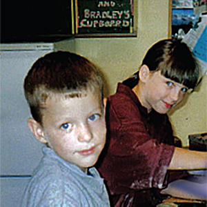 a picture of a young boy and his sister, link opens new PDF browser window