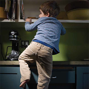 a picture of a boy climbing shelves, link loads PDF document in new browser window