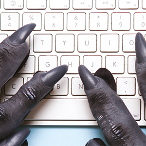 a picture of troll hands on a keyboard, link opens new PDF browser window